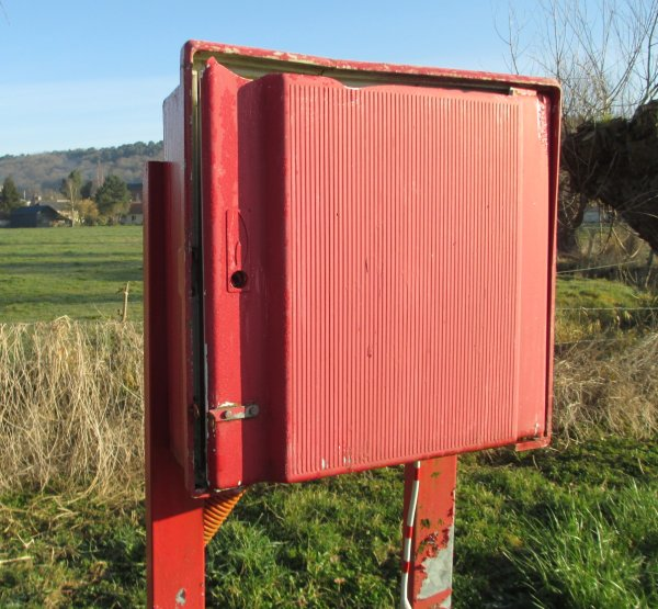 Red-painted metal box at Brionne site
